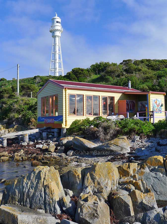 Boat House Restaurant (with no food) and Currie lighthouse, King Island