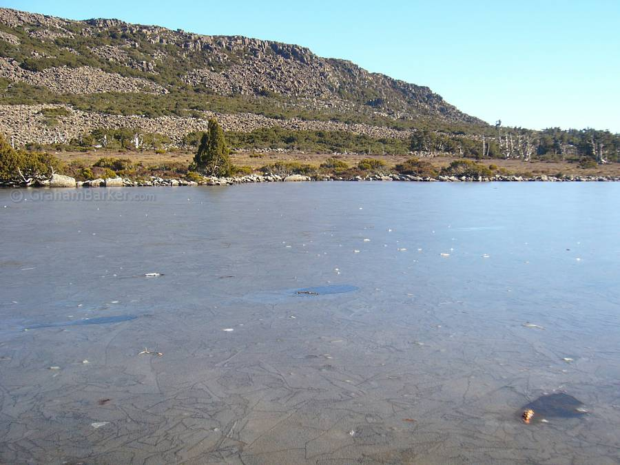 Lightly frozen lake surface, Pine Lake, Tasmania