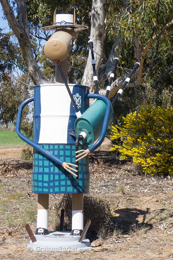 Playing bagpipes. Tin Horse Highway, Kulin, Western Australia